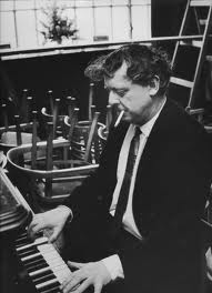 Anthony Burgess composing and smoking after stacking the chairs.  A true multi-tasker.